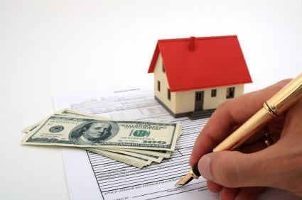 person filling out house financial documents