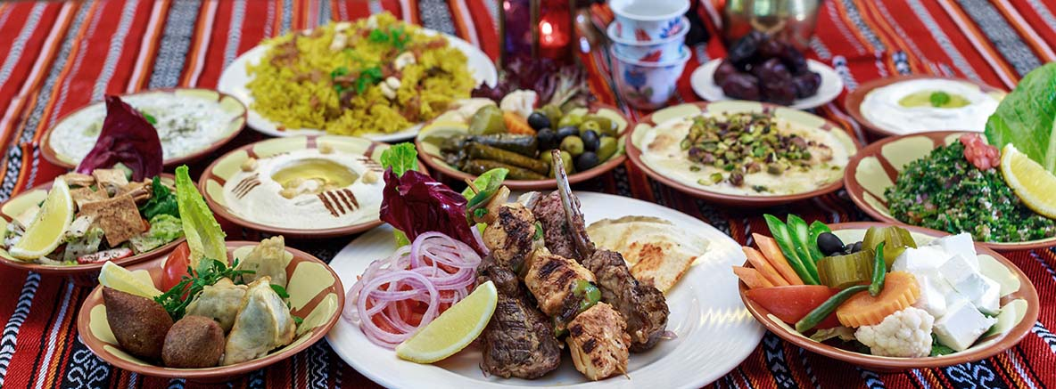 An image of several plates of food for Ramadan Iftar