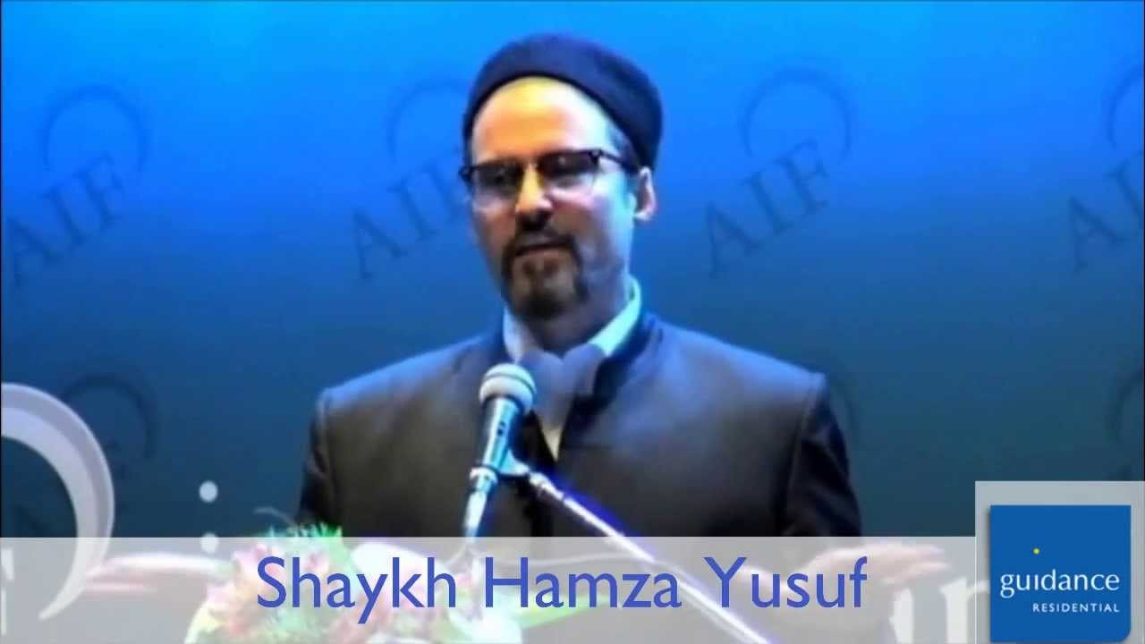 Shaykh Hamza Yusuf at a podium
