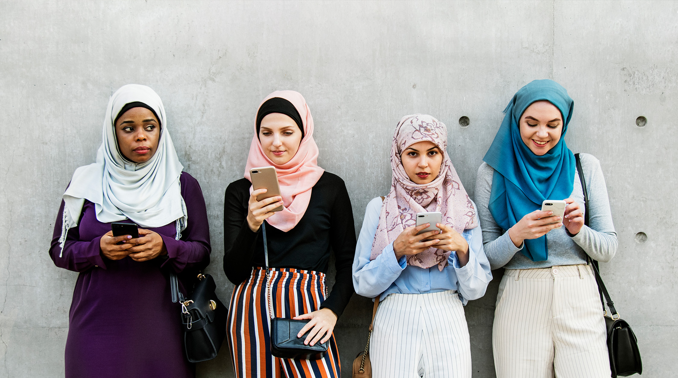 Four women using mobile phone image