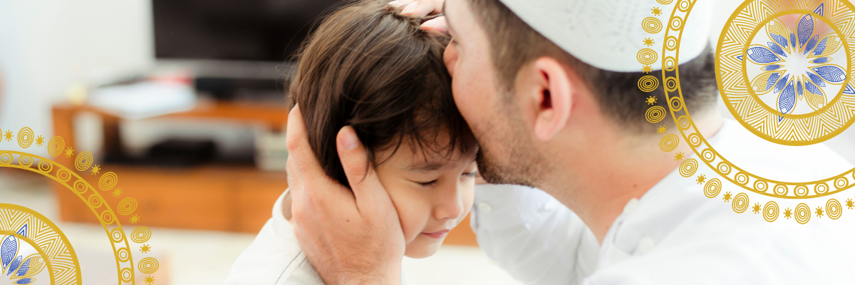 Man kissing a child in the forehead image